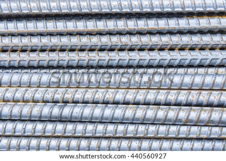 The steel deform bar or steel rod pile on the construction site with the  corrosion  cause of rusty.