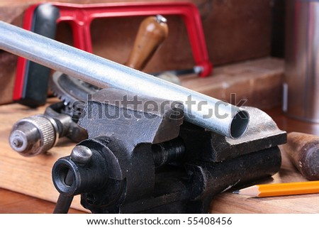 The steel pipe is fixed in a joiner's vice for the further processing.