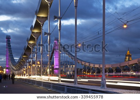 The steel suspension Krymsky Bridge at night in Moscow, Russia - stock photo