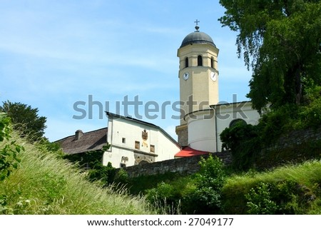 The steeple stands close to the castle Sovinec in the Czech Republic