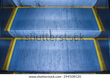 The steps of the escalator in the metro - stock photo