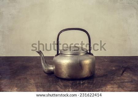 the still life old aluminium kettle - stock photo