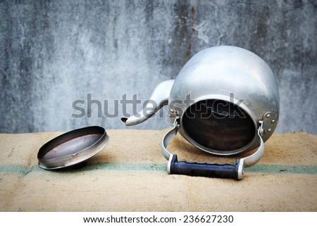 the still life old aluminium kettle on sacks - stock photo