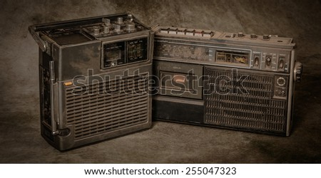 the still life retro radios on grunge background