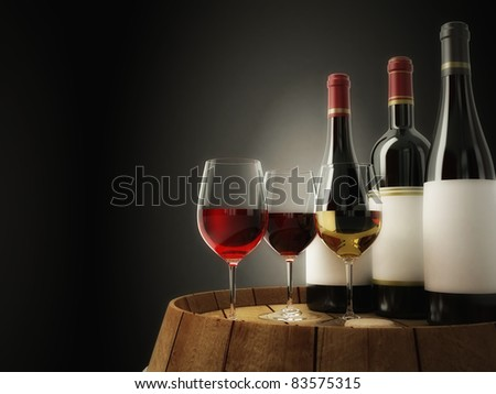 The still life with three kind of wine on old barrel