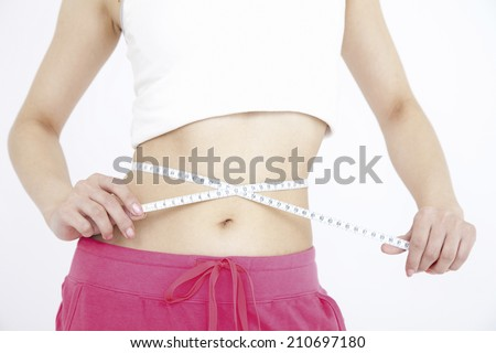 The Stomach Of The Woman Measuring The Size Of Her Waist