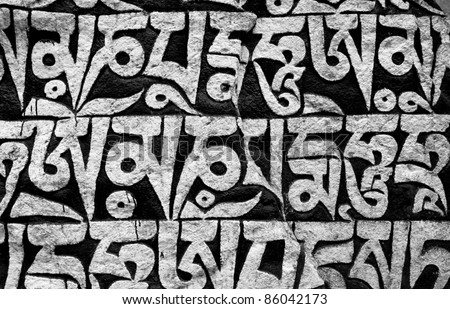 The stone along nepali trek on which a buddhist mantras - stock photo