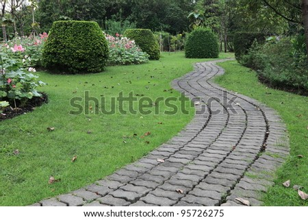 The Stone block walk path in the park - stock photo