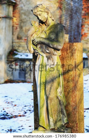 The stone Girl on Tomb from the old Prague Cemetery, Czech Republic - stock photo