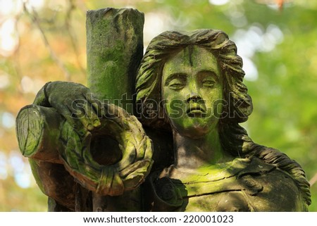 The stone Girl on Tomb from the old Prague Cemetery, Czech Republic