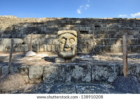 The stone head in the ancient Mayan city of Copan in Honduras. - stock photo