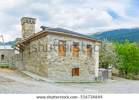 The stone house with the old towers on the background, Mestia, Upper Svaneti, Georgia.