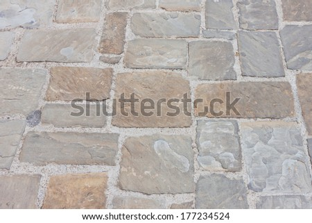 The stone pavement as the background texture - stock photo