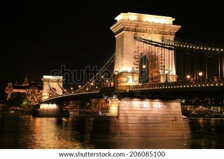 The stone pillars of the Chain bridge at night, Budapest, Hungary - stock photo