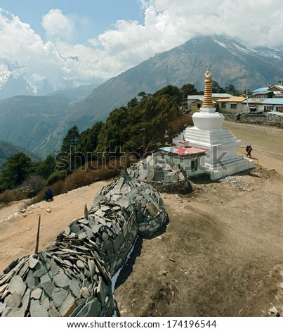 the stones with a buddhist mantras in Tengboche monastery - Nepal, Himalayas - stock photo