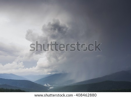 the storm is coming over the mountains, impending squall with rain, impending hurricane, impending rain, approaching storm natural disaster, tempest - stock photo