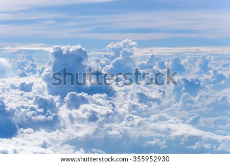 The stormy and fluffy clouds shined from above with the sunlight, view from airplane Windows. Sunny sky abstract background, beautiful cloudscape, on the heaven. Freedom concept - stock photo
