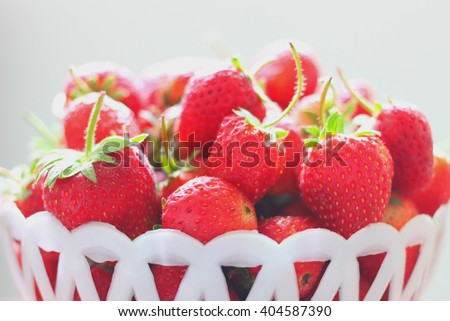 The strawberry in the basket with selective focus on the front strawberry - stock photo