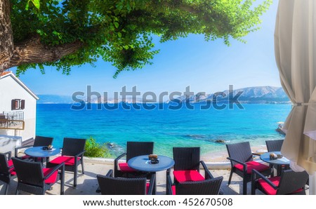 the street and city beach a summer terrace seaside view of traditional european mediterranean restaurant - stock photo