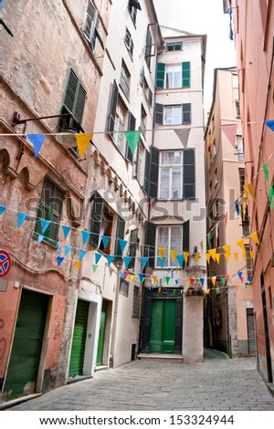 The street decorated with colorfull flags, Genoa, Italy - stock photo