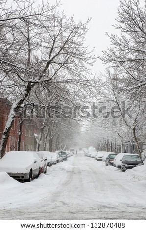 The street filled with fresh snow during a snow storm - stock photo