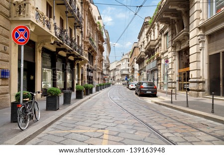 The street with ancient buildings in the center of Milan, Italy - stock photo