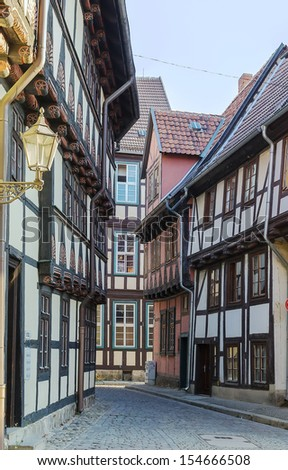 the street with half-timbered houses in Quedlinburg, Germany. In downtown a wide selection of half-timbered buildings from at least five different centuries are to be found