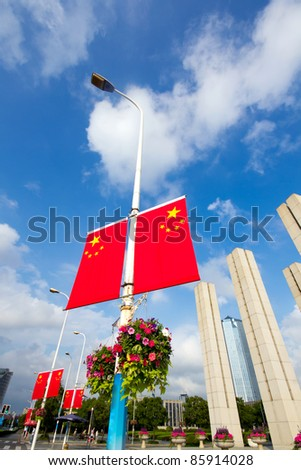 The streets of China flag, blue sky - stock photo