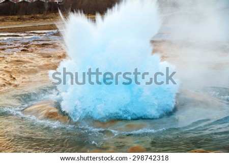 The Strokkur Geyser erupting at the Haukadalur geothermal area, part of the golden circle route, in Iceland - stock photo