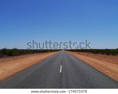 The Stuart Highway from Adelaide to Darwin in Australia - stock photo