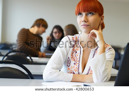 The student in glasses works on notebook - stock photo