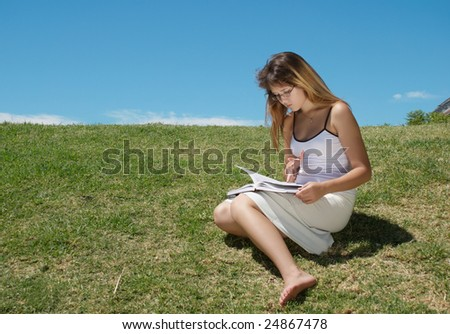 The student with the book  in park - stock photo