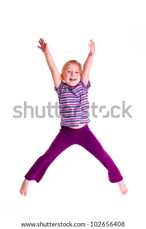 the studio shot of young girl jumping