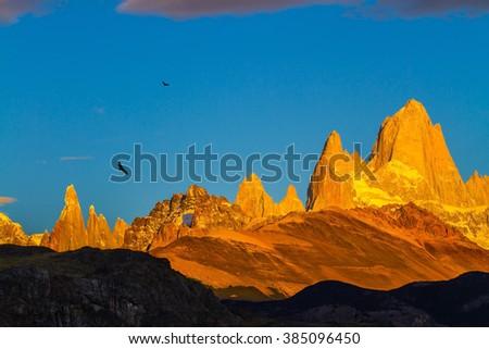The stunning Patagonia. Fiery sunset illuminates the spectacular cliffs Fitz Roy - stock photo