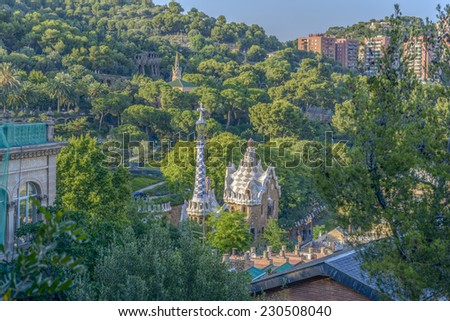 The stunningly vibrant colours and twisting shapes of the Spanish architect Gaudi's famous Parc Guell in Barcelona, Spain - stock photo