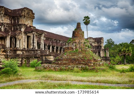 The stupa at the back entrance to Angkor Wat in Cambodia. Stupas originated as pre-Buddhist burial mounds but were more commonly used to house relics. - stock photo