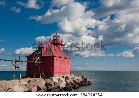 The Sturgeon Bay Canal North Pierhead Light stands at the end of a long jetty to guide boaters and ships to the entrance to the Sturgeon Bay, Wisconsin canal. - stock photo