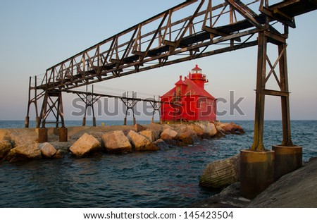 The Sturgeon Bay Ship Canal Pierhead Lighthouse at dusk. Wisconsin, USA - stock photo
