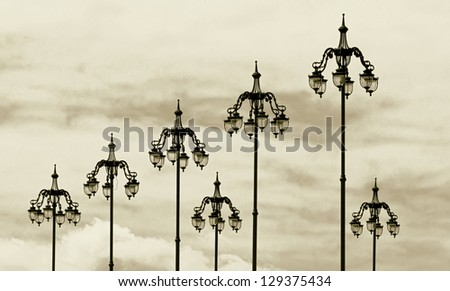 The style of old lamps on the bridge near the Moscow Kremlin, Russia (stylized retro) - stock photo