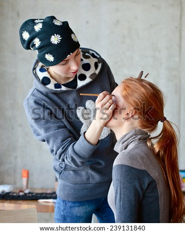 The stylist does a make-up  - stock photo