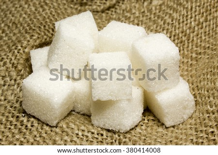 The sugar cubes on the burlap - stock photo