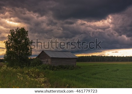 The summer storm is rising over the skies of the rural Finland. The weather is typical on the warm days of the midsummer.