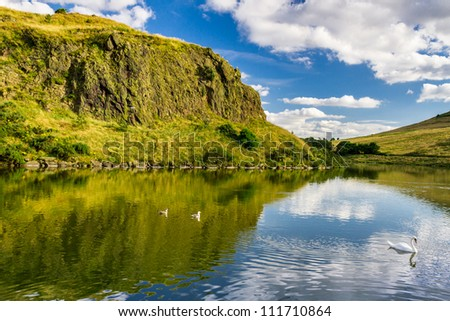 The summer view of the mountains reflected in a lake - stock photo