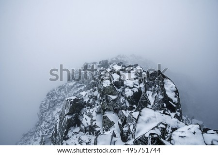the summit of Blanca Peak in a whiteout storm with rime ice