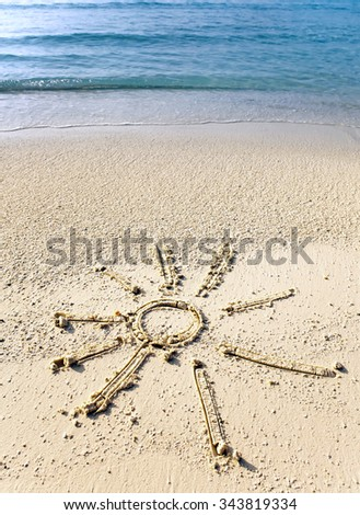 The sun - a picture on sand - stock photo