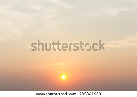 the sun at sunrise with twilight sky background - stock photo