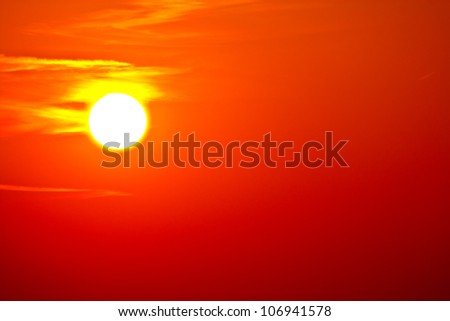 the sun at sunset as a backdrop - stock photo