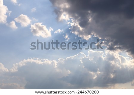 the sun behind the cloud - stock photo