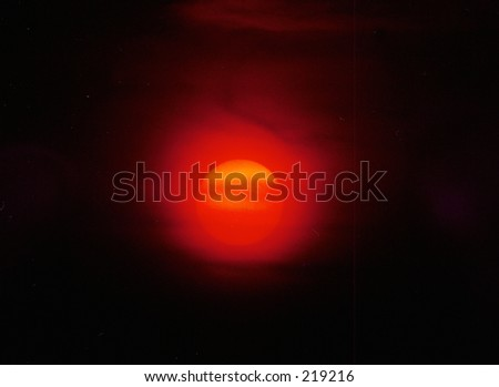 The sun behind the clouds - stock photo