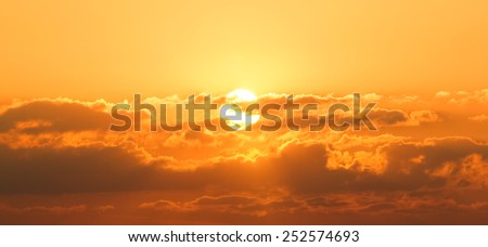 The sun in cloud background.